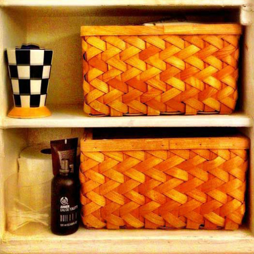 Organisation inside the cupboard - his and hers baskets