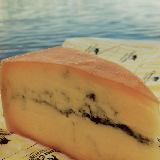 Morbier is a traditional French cheese. The dark stripe is formed by a layer of ash that is added to the first layer of the cheese to protect it overnight.