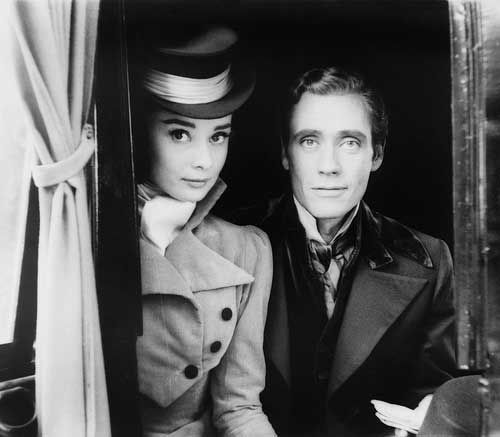 Audrey Hepburn wearing a formal cravat.