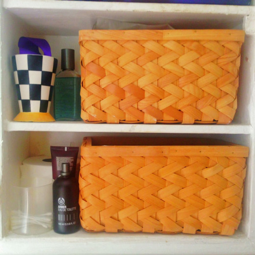 We each have a basket in the bathroom cupboard to hold toiletries that are used regularly
