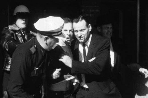 Lee Harvey Oswald being arrested.