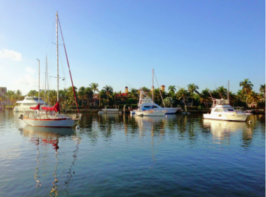 Boats and tranquil waters in the Venice of America.