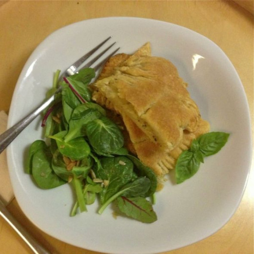 Serve cheese and onion pasties with salad