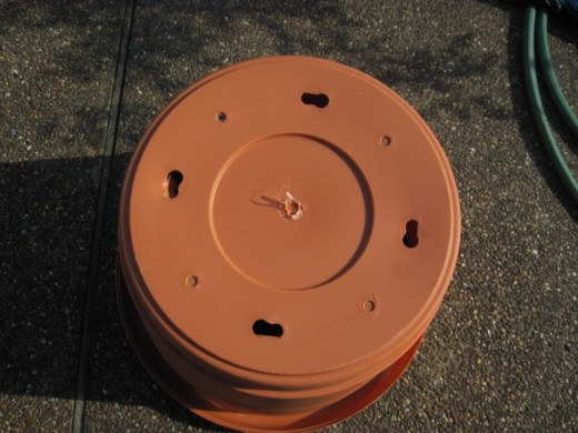 Make sure there are holes in the bottom of the pot.  If there are not holes, you will need to drill drainage holes in the bottom of your pot.