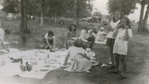 Old photo of a family picnic from decades ago