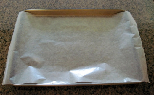 Cover the Cookie Sheet with Wax Paper