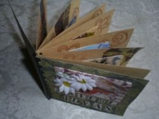 hand-made book for displaying artist trading cards