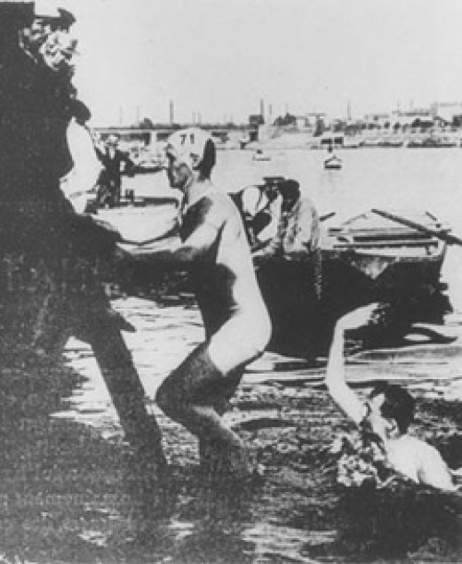 Gold Medal Winning Australian Frederick Lane climbing out of the river after competing in the 1900 Paris Olympics' swimming obstacle race.