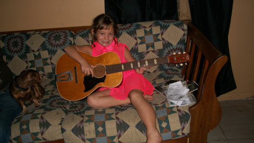 Our guest visitor for the evening. She is 8 years old and has played guitar for 3 months. She is playing a 1975 Stella Harmony.