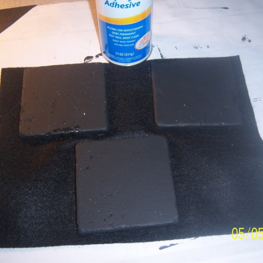 Felt bottoms were applied with spray adhesive. They were weighted with books to make sure that the adhesive held;
