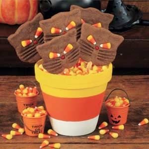 The link will take you to the tutorial. Just beyond being cute, these pots can be used for almost anything. You can do the obvious and plant something. They can be frilled with Halloween treats. The list is endless.