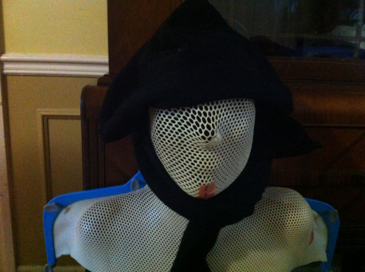 Black hat with attachable scarf.