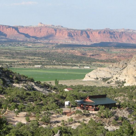 House on Boulder Mountain with Capital Reef in the background