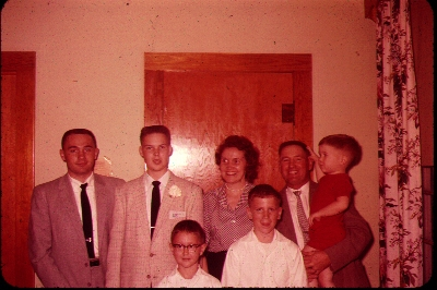That's me on the left, with my parents, and four younger brothers.