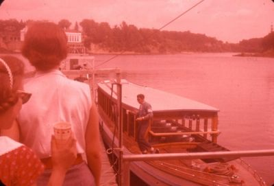 Nancy (red dress, lower left) boarding boat to tour Wisconsin Dells