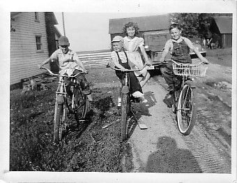 This is in 1947, two neighbors and my three year old brother... I'm on the right on my bike! Mom took this one as well.