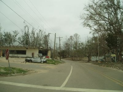 The local gas station with a mangled car in front of it