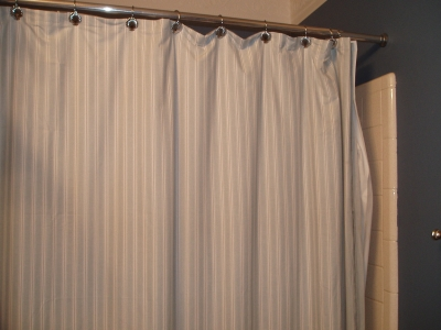 A shower curtain made from a flat twin sheet. Just use the old one as a pattern