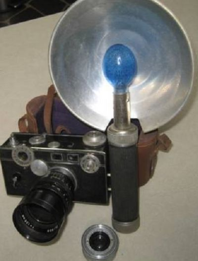 A camera with a flash attachment and a disposble flash bulb