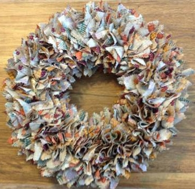 Squares of fabric poked into a straw wreath. You can use pinking shears on the edge of each square.