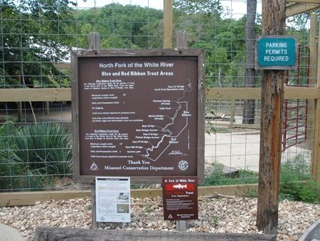 A map and description of the trout fishing areas of the North Fork of the White River, behind the sign.