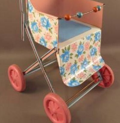 A 1950-60 era tin stroller