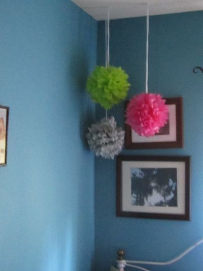 Tie a knot at the hanging end, use a push pin or straight pin and pushit into the ceiling to hang,