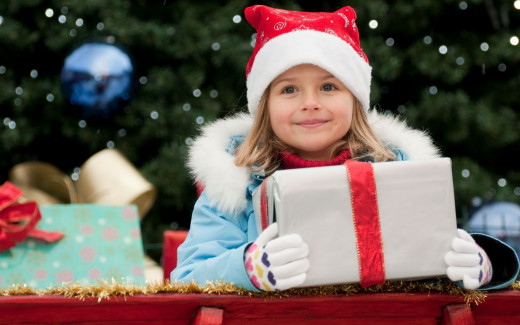 One of my grandchildren outside on our gift display.  She thinks all the presents are for her.