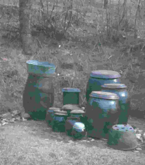 Cooking pots and kimchi pots (for hot pickled cabbage) kept outdoors.