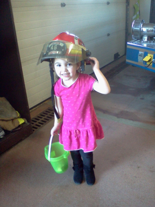 Maybe the future Captain of East Windsor Fire #2, my granddaughter checking out my helmet to make sure it's ready to go
