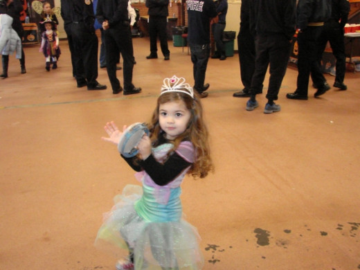 Princesses lead the show with tambourines and favors provided by the DJ