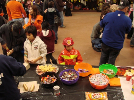 Bowls of candy, trays of cookies and cups of popcorn are kept filled and ready for kids of all ages thanks to our generous sponsors.