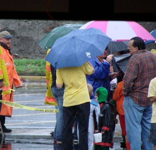 All the brave and determined guests wait patient in the rain with their umbrellas for their fire truck ride.  Nothing washes away the spirit when it comes to a fire truck!