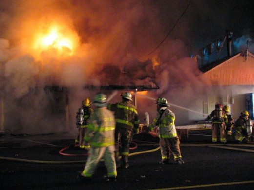 Scene of a motel fire with heavy fire showing on arrival, started by careless cooking when one of the long term motel residents fell asleep while cooking.
