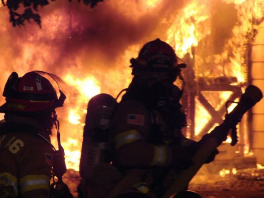 """Captain and LT lead off the attack with a 2 1/2"""" on a residential structure fire. OK that's me in the back, I let him have the nozzle on this one."""