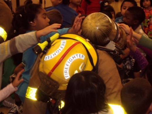 Firefighters Interacting With Kids