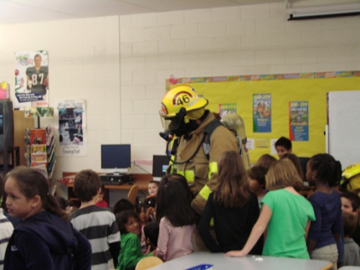 Children will usually swarm all over the firefighters once they get a chance to interact with them