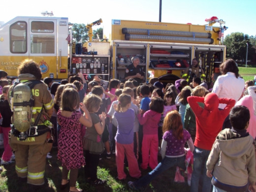 Firefighters love to show off their fire trucks and children of all ages, including adults, love to learn about fire engines and all the different kinds of equipment we bring with us to emergencies