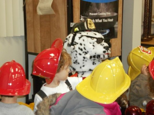 Sparky the fire dog is one of our biggest firefighter helpers during fire prevention. Dressing up in firefighter helmets the children love to listen to Sparky and his fire safety tips.