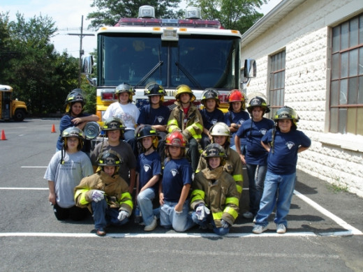 "At the end of the Firefighter Youth Academy the teenagers demonstrated all the skills they had learned to their family and friends who were invited to join us. They hooked up hydrants, extinguished fires and rescued our ""dummy"" from the theatrical sm"