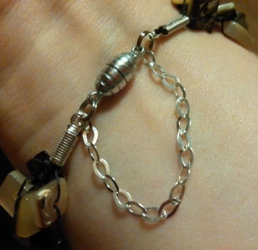 When the clasp is not stuck together, the bracelet with the added length of chain slips easily over the hand. Pull the clasp together and presto!