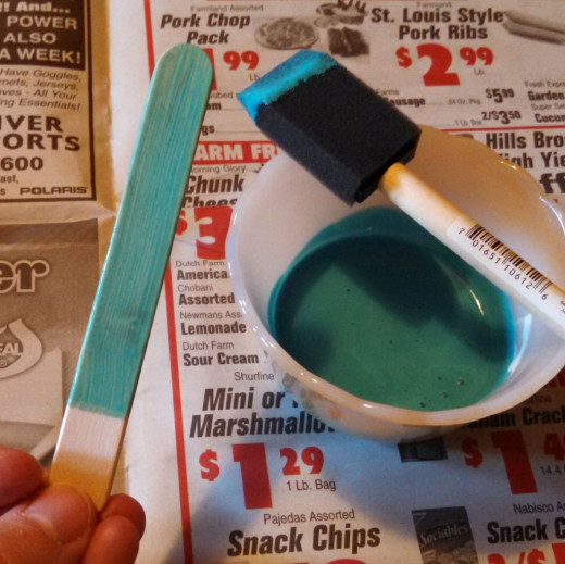 Add food coloring to Mod Podge until desired color. Paint a single layer on the stick making sure to cover both sides and the edges.