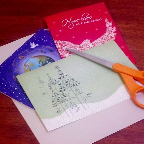 Start with a sheet of cardstock and any greeting cards you would like to use for weaving.