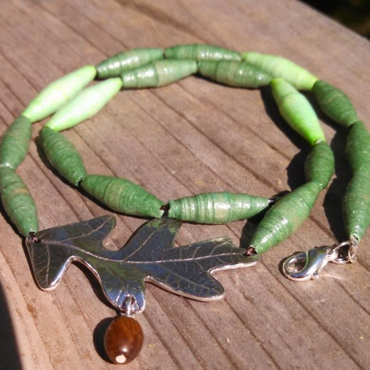 Your dyed, upcycled paper bead necklace ready to wear.