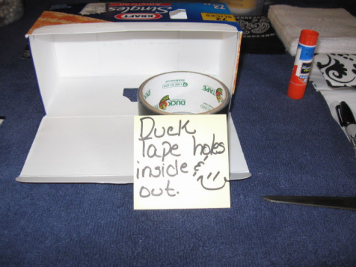 My box had a window hole on each side. I used Duck Tape to patch the holes on the inside and outside of the box.