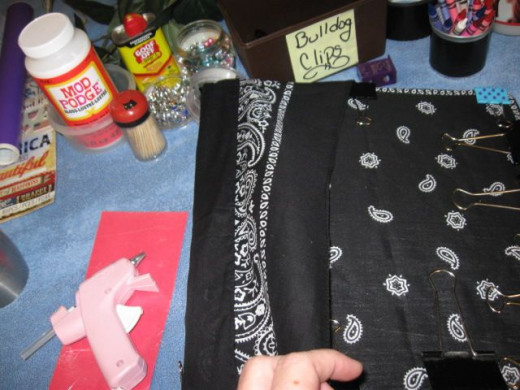 If you want the border, like I did, fold the bandanna back over onto itself. There is a good bit of fabric left after the spine depending on how you arrange it.A WORD ABOUT THE GLUE - You will see some spots where the glue seems to discolor the fabri