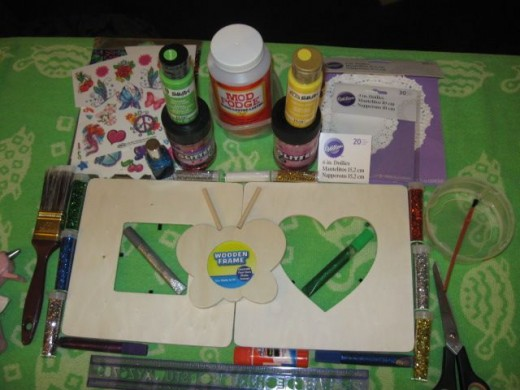 The stuff: Unfinished wood frames, acrylic paint, brushes, stickers, peel and stick gem studs, glitter glue.