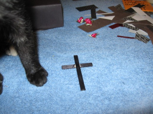 The cross for Vlad's grave (that's who is buried here) is another crafting stick painted in black Sharpie.