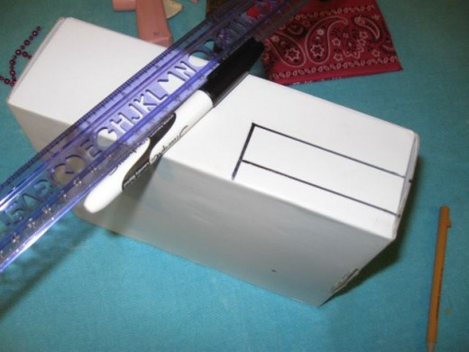 Draw and cut out an opening in the back for electrical cords to go through.