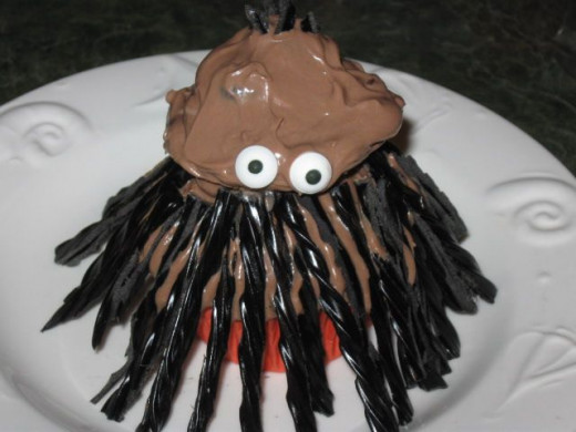 All of it was covered in chocolaty goodness and google eyes were squished in. Voila! One squid!.